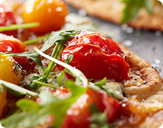 Flatbreads with Caramelized Onions, Tomatoes, Boursin and Arugul